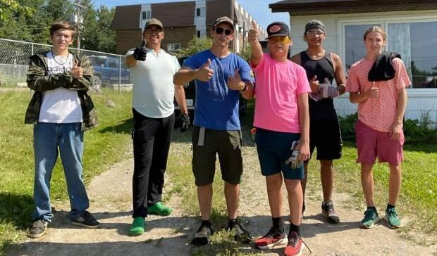 The Men of the North support group encourages men in the Air Ronge and La Ronge area to seek lasting positive mental, physical, emotional and spiritual well-being. The young men in the program are taking on a '40-yard challenge,' working to clean up the yards of 40 elders in their community. (Submitted by Men of the North - image credit)