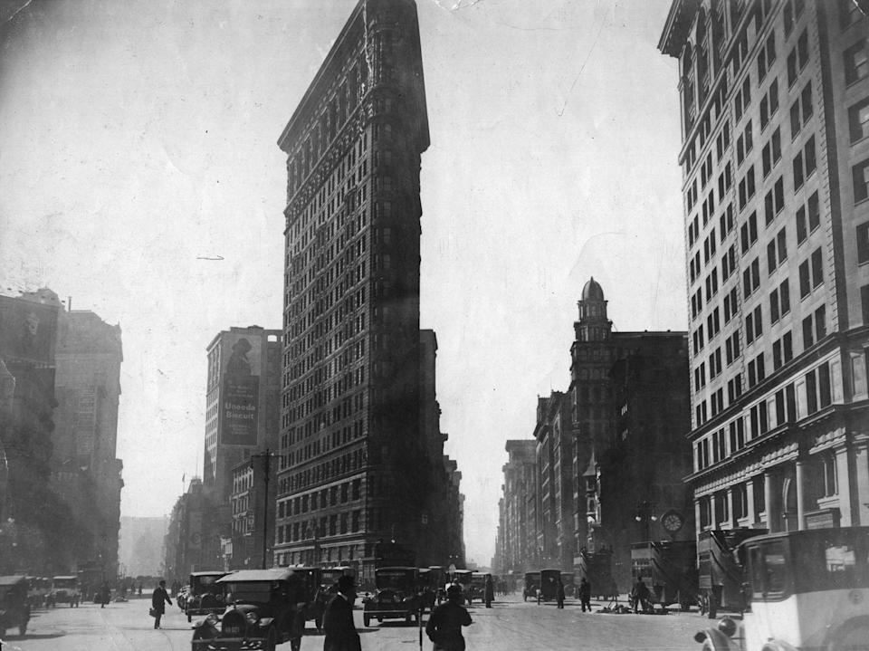 <p>The Flatiron Building, which was built in 1902, stands at the intersection of 23rd Street, Broadway, and Fifth Avenue. </p>