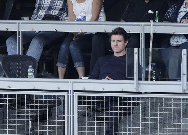 Actor Tom Cruise watches play during the fourth inning of Game 4 of the National League baseball championship series between the St. Louis Cardinals and the Los Angeles Dodgers, Tuesday, Oct. 15, 2013, in Los Angeles. (AP Photo/Jae C. Hong)