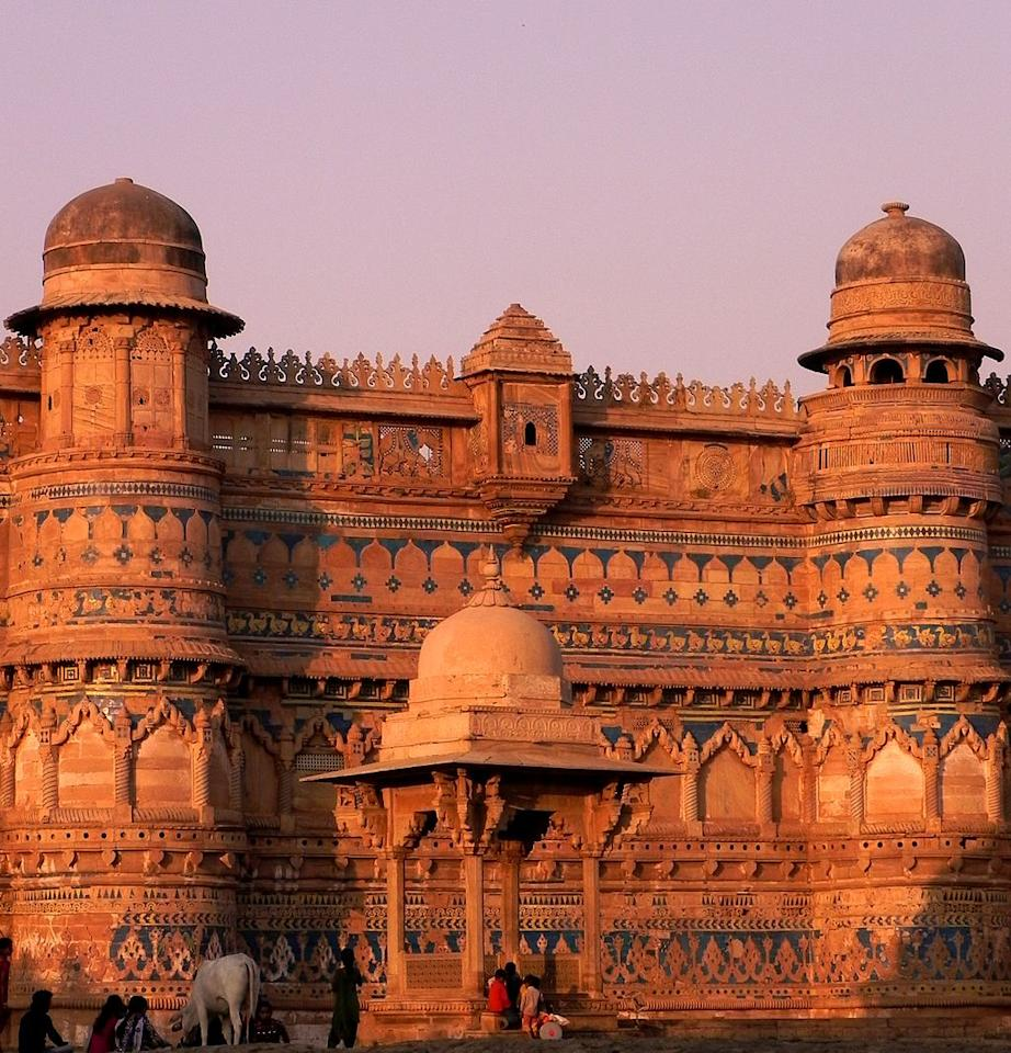 """<p>The Gwalior Fort has existed at least since the 10th century, and the inscriptions and monuments found within indicate that it may have existed as early as the beginning of the 6th century. The present-day fort consists of a defensive structure and two main palaces, Gujari Mahal and Man Mandir. The Gujari Mahal palace was built for Queen Mrignayani. The second oldest record of <i>""""zero""""</i> in the world was found in a small temple, which is located on the way to the top. The inscription is around 1500 years old. (Image: <a rel=""""nofollow"""" href=""""https://commons.wikimedia.org/wiki/File:Gorgeous_Gwalior_Fort.jpg"""">Wikimedia Commons</a>) </p>"""