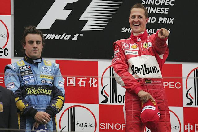 Michael Schumacher of Germany and Ferrari celebrates on the podium as Fernando Alonso looks on after the Formula One Chinese Grand Prix at Shanghai International Circuit on October 1, 2006 in Shanghai, China. (Photo by Clive Rose/Getty Images)