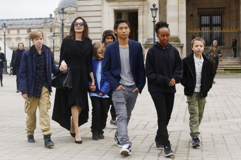 Angelina Jolie with her children Shiloh Pitt Jolie, Maddox Pitt Jolie, Vivienne Marcheline Pitt Jolie, Pax Thien Pitt Jolie, Zahara Marley Pitt Jolie, Knox Leon Pitt Jolie, visit the Louvre in Paris, France, on January 30, 2017. (Photo by Mehdi Taamallah/NurPhoto via Getty Images)