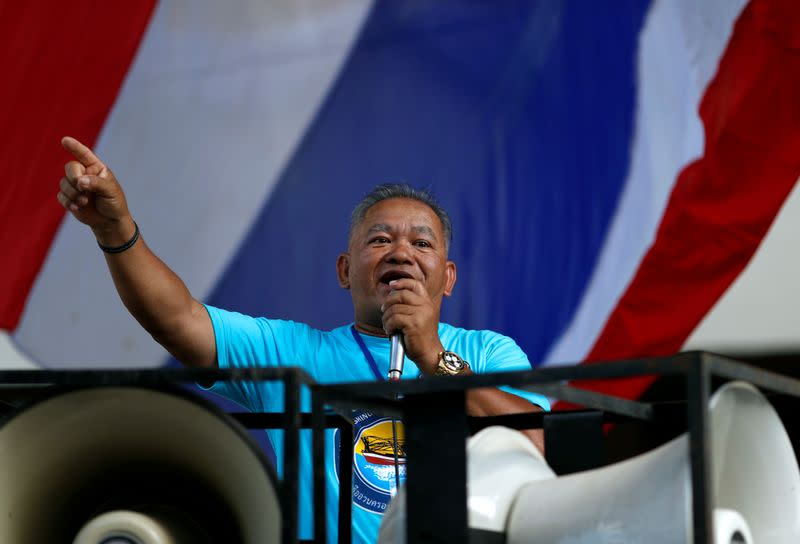 Man talks at a protest outside the Agriculture Ministry in Bangkok