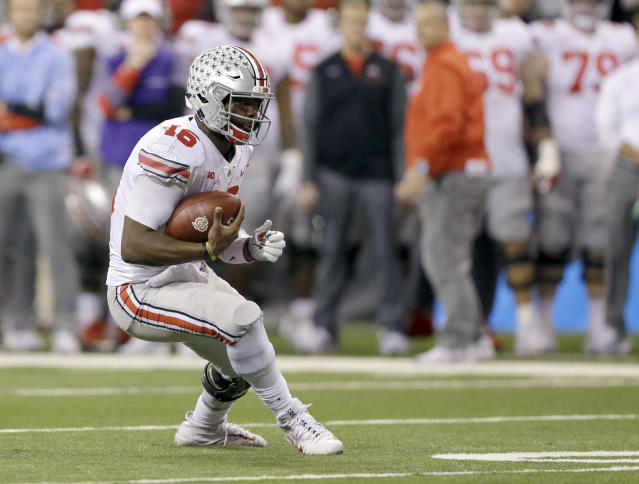 Ohio State quarterback J.T. Barrett runs with the ball during the second half of the Big Ten championship NCAA college football game against Ohio State, Saturday, Dec. 2, 2017, in Indianapolis. (AP Photo/AJ Mast)