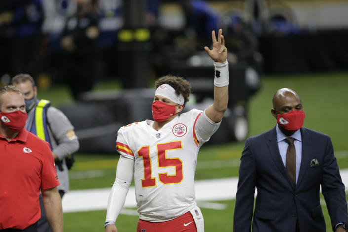Kansas City Chiefs quarterback Patrick Mahomes (15) waves as he walks off the field after an NFL football game against the New Orleans Saints in New Orleans, Sunday, Dec. 20, 2020. The Chiefs won 32-29. (AP Photo/Brett Duke)