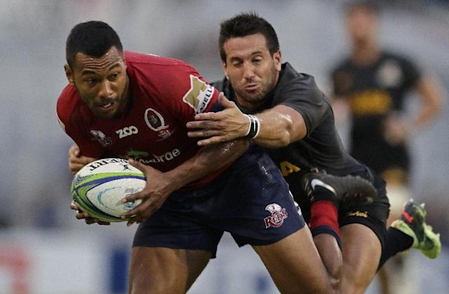 Queensland Reds fullback Aidan Toua (left) is tackled by Jaguares centre Santiago Iglesias (AFP Photo/Alejandro PAGNI)