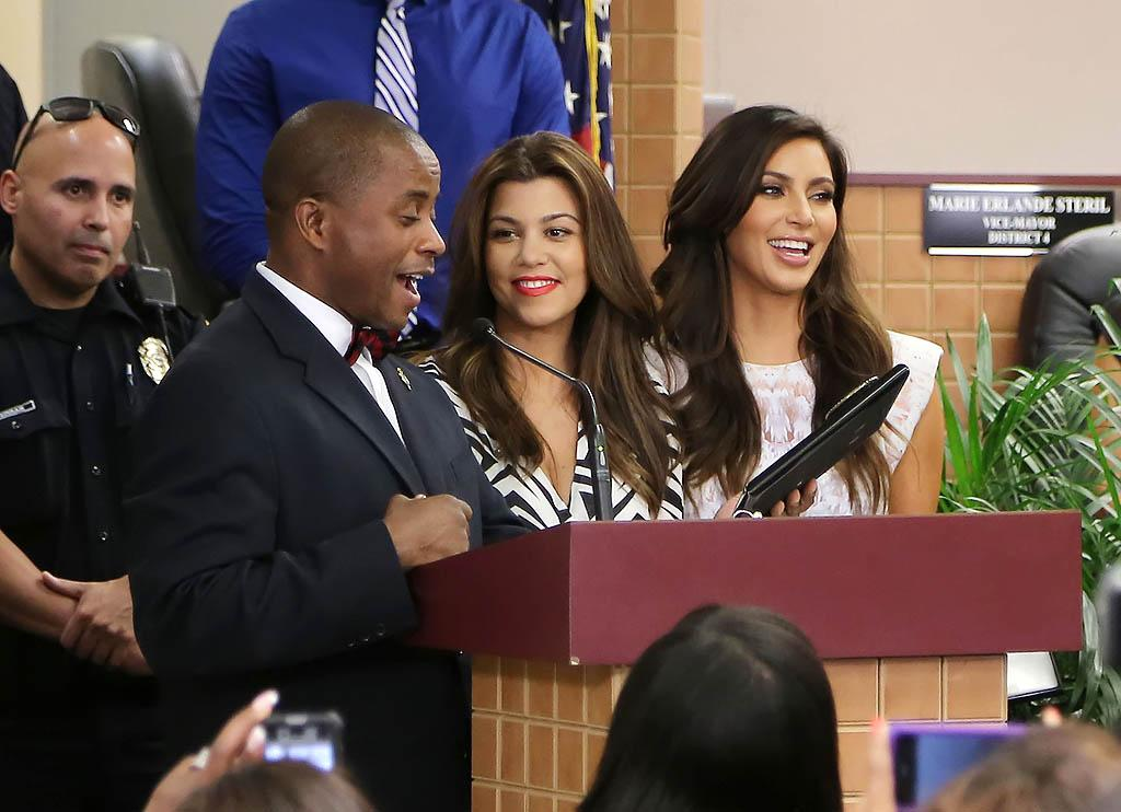 NORTH MIAMI, FL - NOVEMBER 19: City of North Miami Mayor Andre D. Pierre, Kourtney Kardashian and Kim Kardashian make an appearance at North Miami City Hall to receive keys to the City of North Miami on November 19, 2012 in North Miami, Florida. (Photo by Alexander Tamargo/Getty Images)