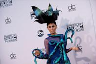 <p>The singer (born as Tania Muradian) is known for singing in 14 different languages and her outlandish wardrobe. Here she was adorned with a giant octopus and dramatic headpiece, and her aqua talons were the wildest nails on the red carpet. <i> (Photo: Getty Images)</i></p>