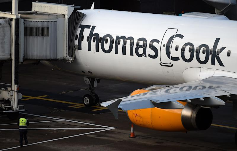 A Thomas Cook passenger aircraft stands on the tarmac at Manchester Airport in Manchester, northern England on Septmeber 23, 2019, after the company announced it was taking steps to enter into compulsory liquidation with immediate effect. - British travel group Thomas Cook on Monday declared bankruptcy after failing to reach a last-ditch rescue deal, triggering the UK's biggest repatriation since World War II to bring back tens of thousands of stranded passengers. The 178-year-old operator, which had struggled against fierce online competition for some time and which had blamed Brexit uncertainty for a recent drop in bookings, was desperately seeking £200 million ($250 million, 227 million euros) from private investors to avert collapse. (Photo by Oli SCARFF / AFP) (Photo credit should read OLI SCARFF/AFP/Getty Images)