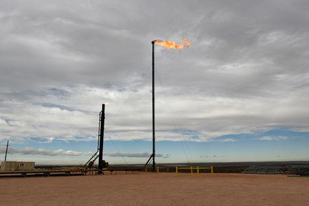 Natural gas flares off at a production facility owned by Exxon near Carlsbad, New Mexico, U.S. February 11, 2019. REUTERS/Nick Oxford