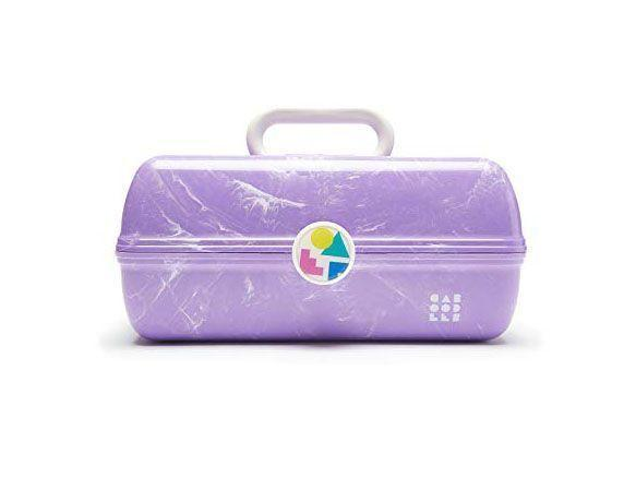 """<p><strong>Caboodles</strong></p><p>amazon.com</p><p><strong>$20.35</strong></p><p><a href=""""https://www.amazon.com/dp/B082QC963F?tag=syn-yahoo-20&ascsubtag=%5Bartid%7C10055.g.4742%5Bsrc%7Cyahoo-us"""" rel=""""nofollow noopener"""" target=""""_blank"""" data-ylk=""""slk:Shop Now"""" class=""""link rapid-noclick-resp"""">Shop Now</a></p><p>This gift might be more of a flashback to your childhood, but she'll love it just the same. Fill this colorful case with new makeup, face masks, nail polish, and other goodies to show her how it's done.</p>"""