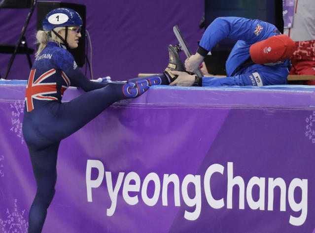 Elise Christie of Britain has repair work done to her skate after falling at the start of her women's 1000 meters short track speedskating heat in the Gangneung Ice Arena at the 2018 Winter Olympics in Gangneung, South Korea, Tuesday, Feb. 20, 2018. (AP Photo/Aaron Favila)