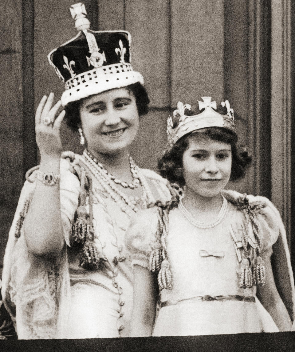 Queen Elizabeth on the day of her coronation in 1936 with her daughter Princess Elizabeth on the balcony of Buckingham Palace, London, England. Elizabeth Angela Marguerite Bowes-Lyon, 1900 –2002. Princess Elizabeth, future Queen Elizabeth II. Elizabeth II, born 1926. Queen of the United Kingdom, Canada, Australia and New Zealand. (Photo by: Universal History Archive/Universal Images Group via Getty Images)