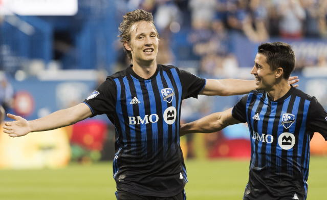 Montreal Impact's Lassi Lappalainen, left, celebrates with teammate Bojan after scoring against FC Dallas during first-half MLS soccer match action in Montreal, Saturday, Aug. 17, 2019. (Graham Hughes/The Canadian Press via AP)