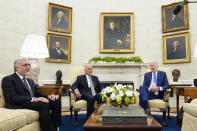President Joe Biden, right, meets with Afghan President Ashraf Ghani, center, and Chairman of the High Council for National Reconciliation Abdullah Abdullah, left, in the Oval Office of the White House in Washington, Friday, June 25, 2021. (AP Photo/Susan Walsh)