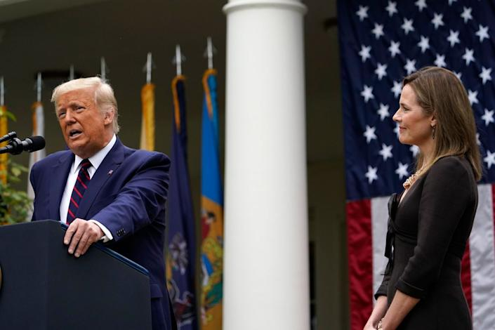 Judge Amy Coney Barrett listens as President Donald Trump announces Barrett as his nominee to the Supreme Court, in the Rose Garden at the White House, Saturday, Sept. 26, 2020, in Washington.