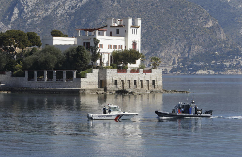 Police officers patrol along the Villa Kerylos in Beaulieu-sur-Mer, southern France, Sunday, March, 24, 2019, where French President Emmanuel Macron and Chinese President Chinese President Xi Jinping will meet. A police boat and police divers worked to secure the area before his arrival, and security cordons blocked several roads in Nice, where Xi will stay overnight. (AP Photo/Claude Paris)