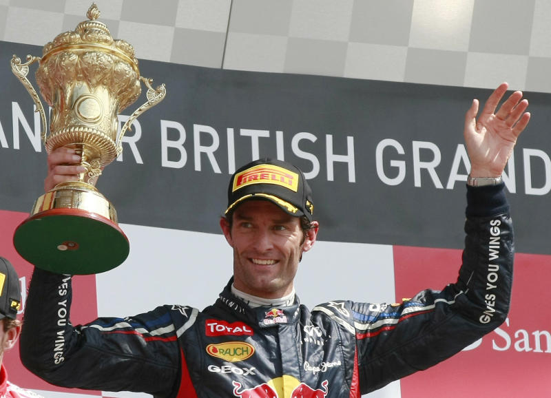 """FILE - This is a Sunday, July 8, 2012 file photo of Australia's Mark Webber, as he celebrates after winning the Formula One British Grand Prix at the Silverstone circuit, Silverstone, England. Red Bull driver Mark Webber says he is leaving Formula 1 to race Porsche sports cars from next season. The Australian's website says in a statement from Porsche that he has signed a contract with the German company """"that extends over several years"""" and that he will compete in the Le Mans 24 Hours and World Endurance Championship next year. (AP Photo/Tim Hales, File)"""