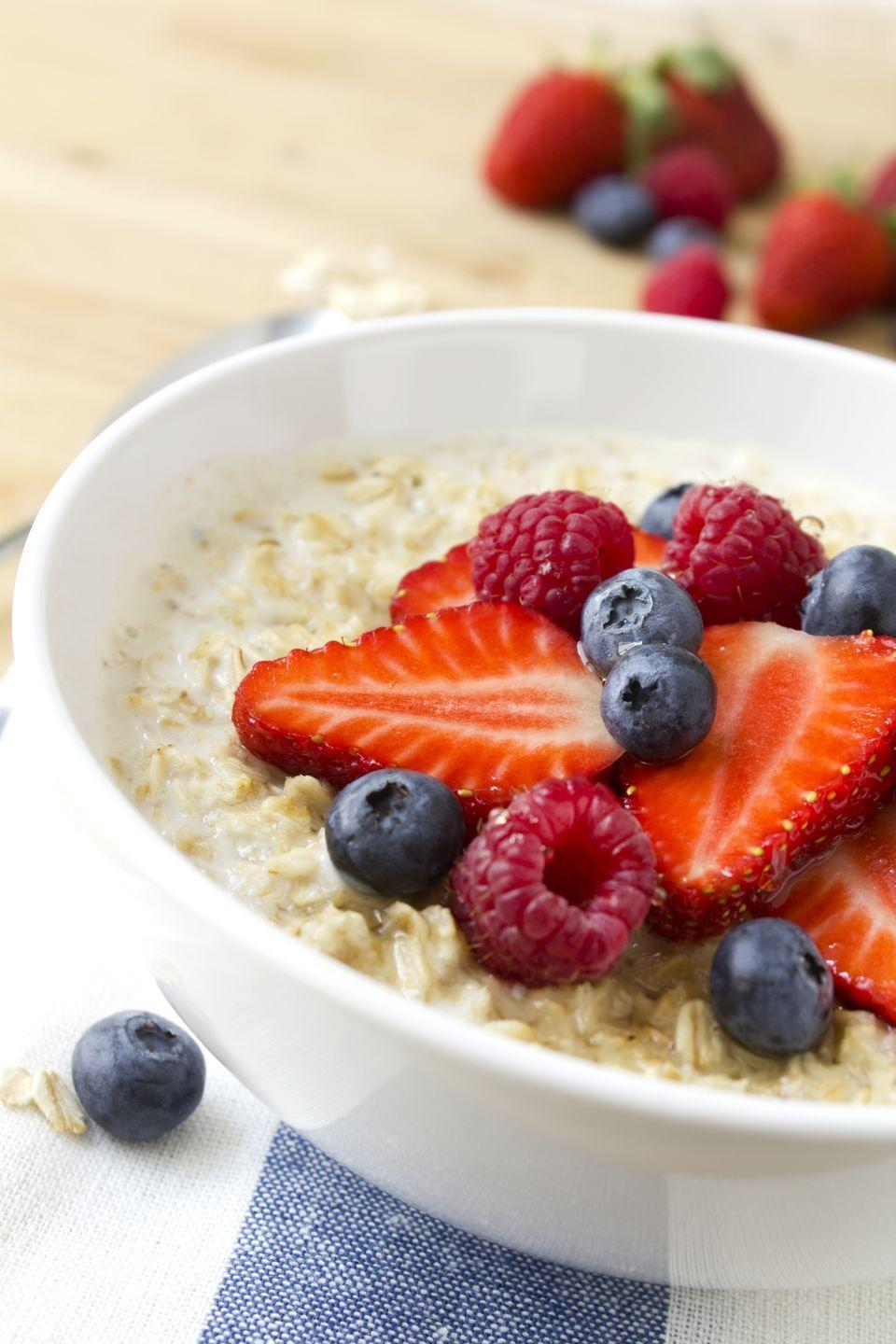 """<p>It may be a favorite for breakfast, but you might want to try eating a bowl of <a href=""""https://www.goodhousekeeping.com/health/diet-nutrition/a31028145/oatmeal-benefits/"""" rel=""""nofollow noopener"""" target=""""_blank"""" data-ylk=""""slk:oatmeal"""" class=""""link rapid-noclick-resp"""">oatmeal</a> after dark for help sleeping through the night. """"Grains in oatmeal trigger insulin production much like whole-grain bread,"""" says <a href=""""https://www.cynthiagarcia.com/"""" rel=""""nofollow noopener"""" target=""""_blank"""" data-ylk=""""slk:Cynthia Pasquella"""" class=""""link rapid-noclick-resp"""">Cynthia Pasquella</a>, CCN, CHLC, CWC. """"They raise your blood sugar naturally and make you feel sleepy. <a href=""""https://www.goodhousekeeping.com/food-recipes/g3703/overnight-oats/"""" rel=""""nofollow noopener"""" target=""""_blank"""" data-ylk=""""slk:Oats"""" class=""""link rapid-noclick-resp"""">Oats</a> are also rich in melatonin, which relaxes the body and helps you fall asleep.""""</p>"""