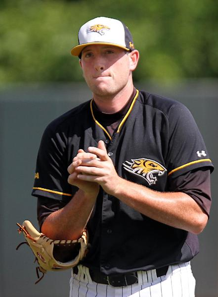 Towson reliever Nik Nowottnick rubs a ball during an NCAA regional tournament college baseball game against Florida Atlantic in Chapel Hill, N.C., Friday, May 31, 2013. (AP Photo/Ted Richardson)