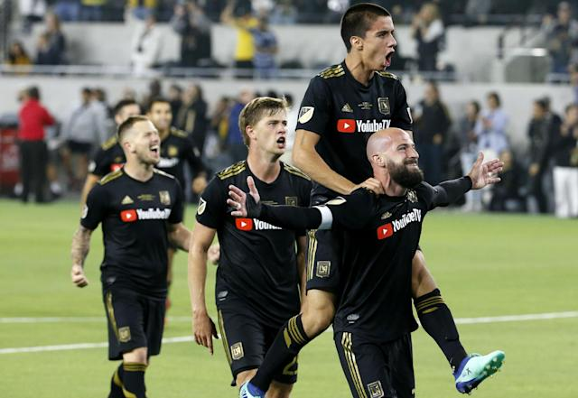 LAFC players celebrate after Laurent Ciman's game-winning strike against Seattle. (AP)