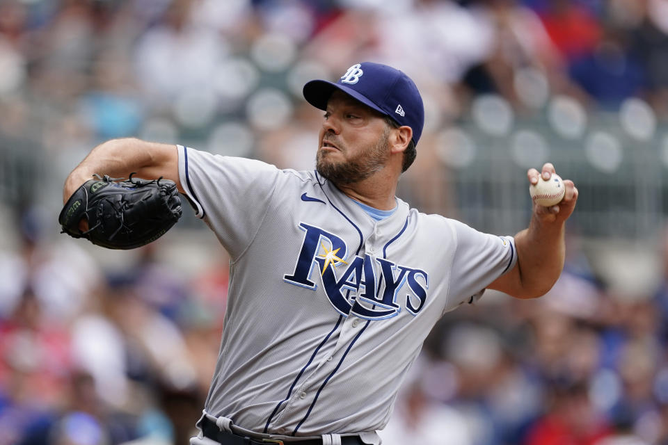 Tampa Bay Rays starting pitcher Rich Hill delivers against an Atlanta Braves batter in the first inning of a baseball game Sunday, July 18, 2021, in Atlanta. (AP Photo/John Bazemore)