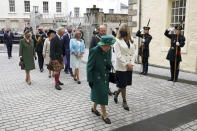 Britain's Queen Elizabeth II, center, arrives at the Scottish Parliament in Edinburgh, followed by Prince Charles and Camilla, Duchess of Cornwall, left, where she will deliver a speech in the debating chamber to mark the official start of the sixth session of Parliament, in Edingurgh, Scotland, Saturday, Oct. 2, 2021. (Andrew Milligan/via AP)