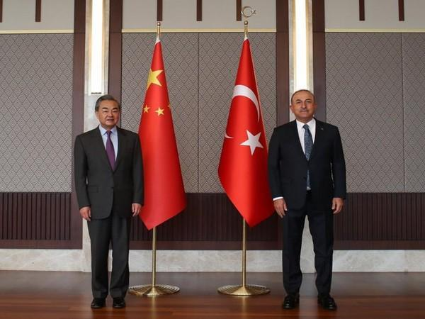 Turkish Foreign Minister Mevlut Cavusoglu and Chinese Foreign Minister Wang Yi