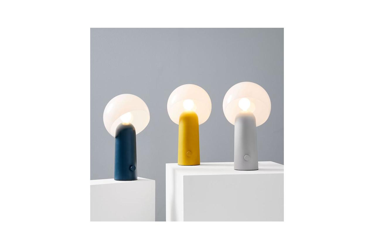 """A yellow table lamp shaped like a mushroom? You love to see it. $100, West Elm. <a href=""""https://www.westelm.com/products/torre-table-lamp-w3432/?pkey=csale-lighting&isx=0.0"""">Get it now!</a>"""