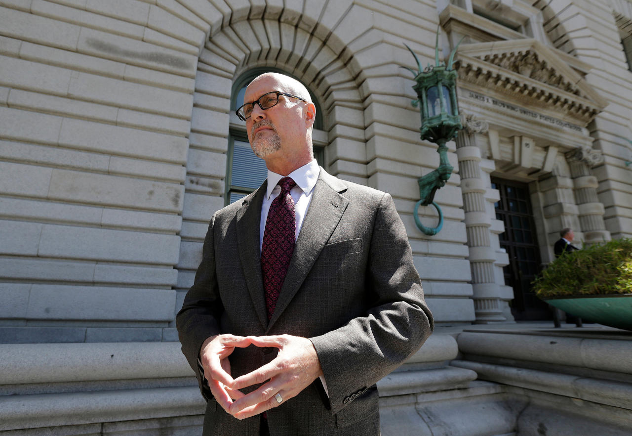 File - In this July 12, 2017, file photo, Jeffrey Kerr, general counsel to the People for the Ethical Treatment of Animals (PETA), speaks to reporters outside of the 9th U.S. Circuit Court of Appeals in San Francisco. A monkey cannot sue over rights to photos that it took because U.S. copyright law does not allow animals to file lawsuits, a federal appeals court ruled on Monday, April 23, 2018, in a novel case over selfies taken by a crested macaque. A unanimous, three-judge panel of the 9th U.S. Circuit Court of Appeals upheld a lower court ruling dismissing a lawsuit by the People for the Ethical Treatment of Animals against David Slater, the photographer whose camera was used by the monkey in 2011 to take the photos. Kerr said the group was reviewing the opinion and had not decided yet whether it would appeal. (AP Photo/Jeff Chiu, File)