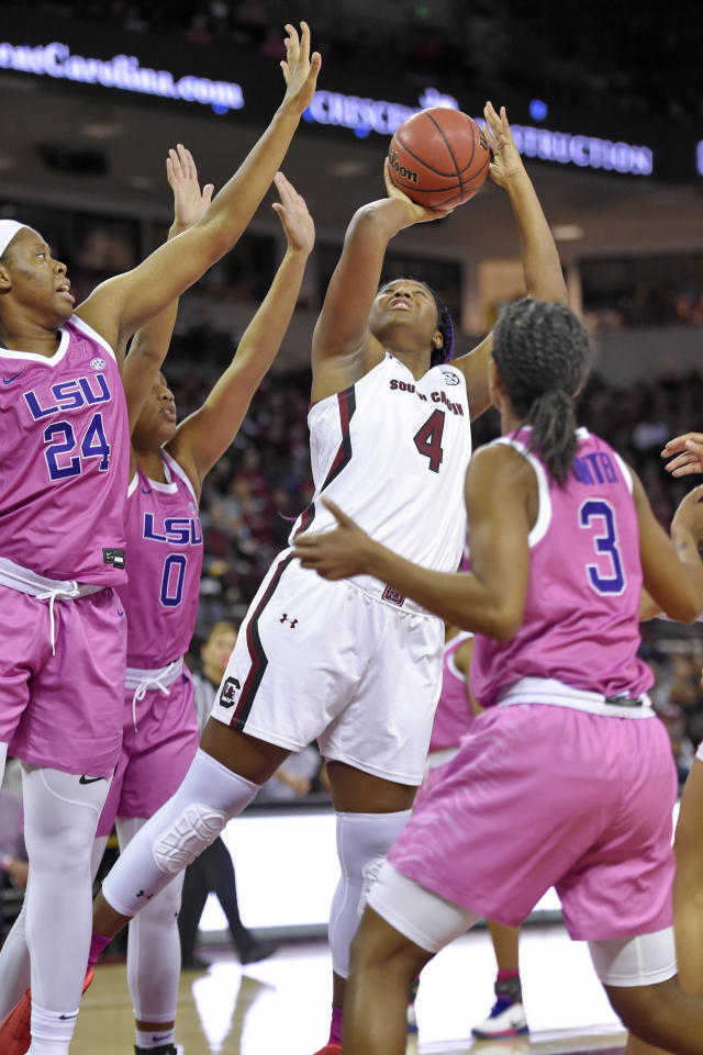 South Carolina's Aliyah Boston (4) shoots while defended by LSU's Faustine Aifuwa (24) Awa Trasi (0) and Khayla Pointer during the first half of an NCAA college basketball game Thursday, Feb. 20, 2020, in Columbia, S.C. (AP Photo/Richard Shiro)