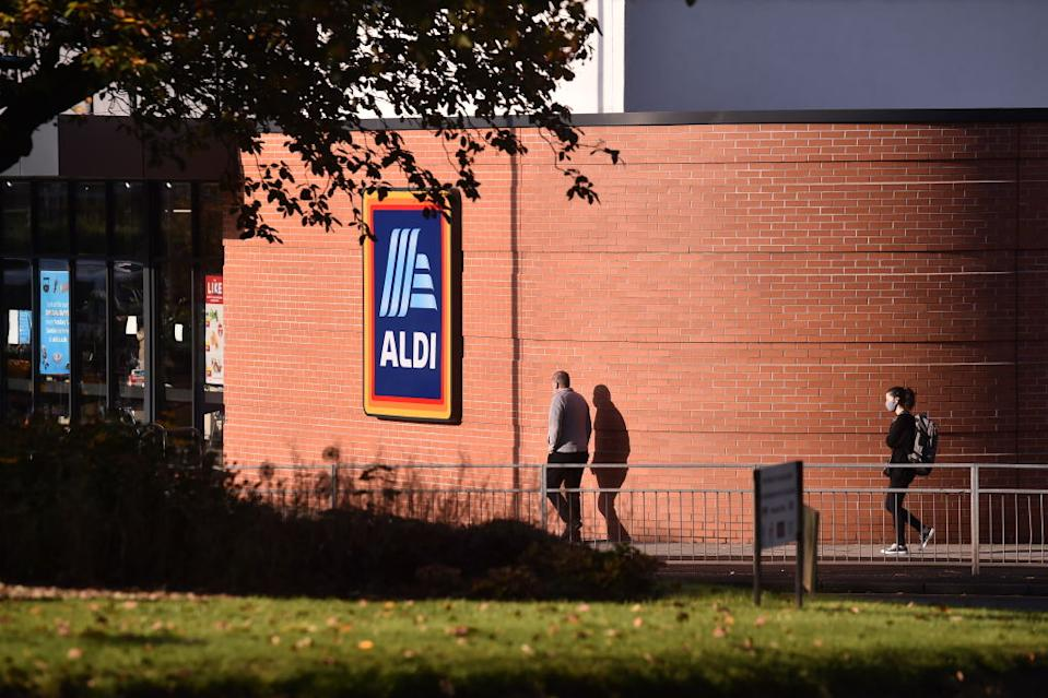 Shoppers are seen walking past an Aldi Supermarket.