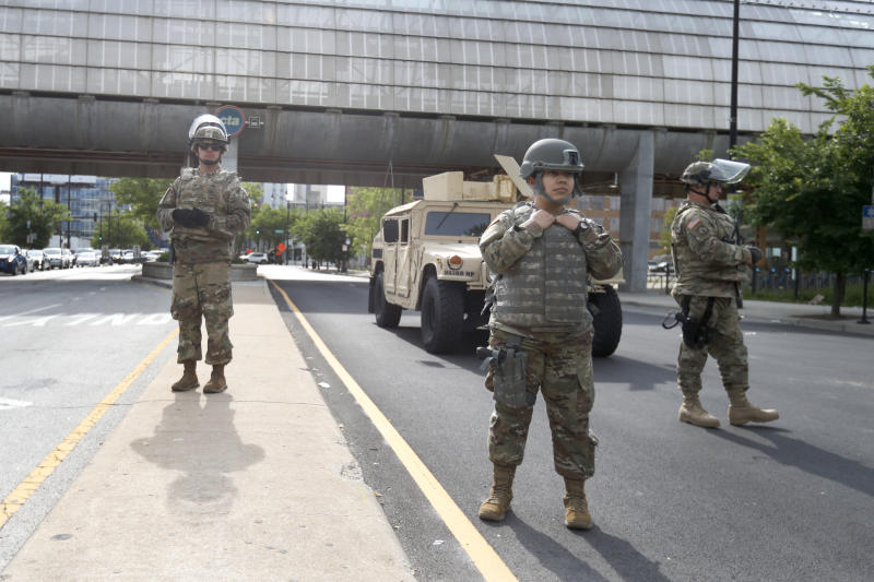 Members of an Illinois National Guard Military Police stand a post, Monday, June 1, 2020, at a security perimeter on Chicago's near Southside. (AP Photo/Charles Rex Arbogast)