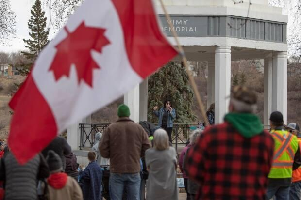 An organizer gives an opening speech during the April 24 rally at the Vimy Memorial at Kiwanis Park.