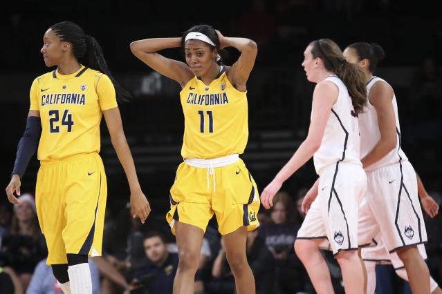 California forward Kyra Dunn (11) reacts alongside forward Courtney Range (24) during the first half of their NCAA college basketball game against Connecticut as part of the Maggie Dixon Basketball Classic at Madison Square Garden, Sunday, Dec. 22, 2013, in New York. (AP Photo/John Minchillo)