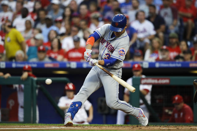 New York Mets' Michael Conforto hits a double off of Philadelphia Phillies starting pitcher Aaron Nola during the first inning of a baseball game, Friday, Aug. 30, 2019, in Philadelphia. (AP Photo/Matt Rourke)