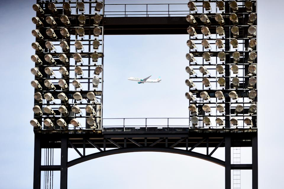 ST LOUIS, MO - APRIL 11: A Frontier plane flies past a game between the St. Louis Cardinals and the Milwaukee Brewers at Busch Stadium on April 11, 2018 in St Louis, Missouri. (Photo by Jeff Curry/Getty Images) *** Local Caption ***