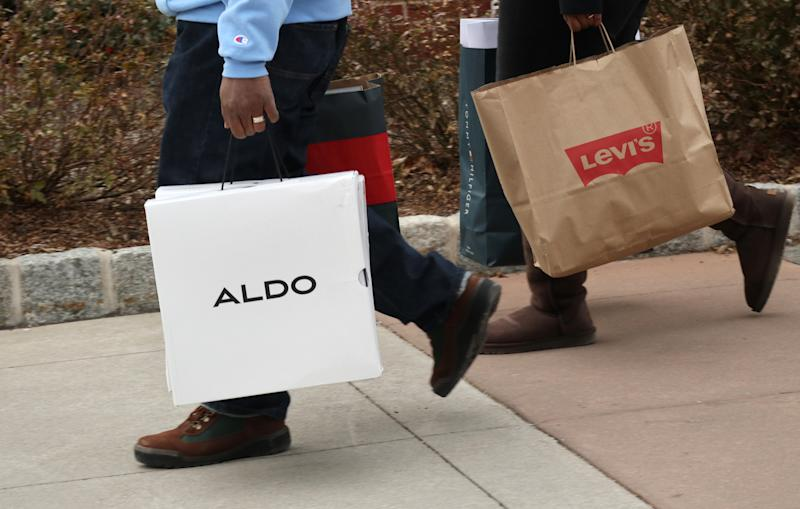 CENTRAL VALLEY, NY - NOVEMBER 17: People carry Aldo and Levis bags at the Woodbury Common Premium Outlets shopping mall on November 17, 2019 in Central Valley, New York. (Photo by Gary Hershorn/Getty Images)
