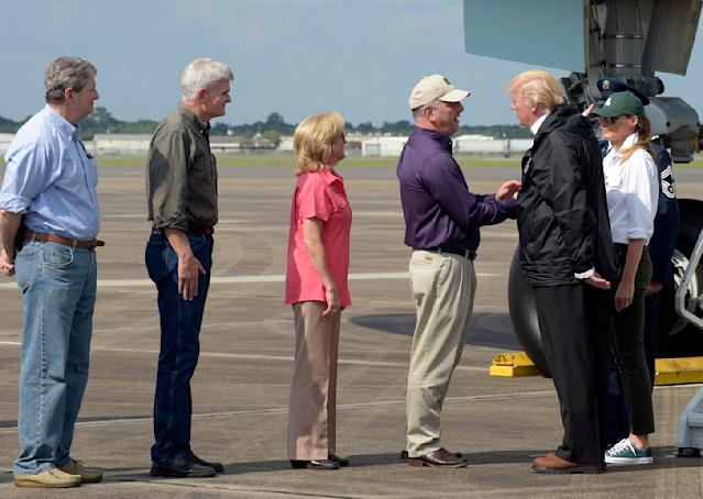 <p>President Donald Trump and first lady Melania Trump meet Louisiana Gov. Governor John Bel Edwards, third from right, and his wife Donna, center, after arriving at Chennault International Airport in Lake Charles, La., to meet people at a county emergency operations center dealing with the impact of Hurricane Harvey, Saturday, Sept. 2, 2017. Other greeting the Trump's are, from left, Sen. John Kennedy, R-La., and Sen. Bill Cassidy, R-La. (Photo: Susan Walsh/AP) </p>