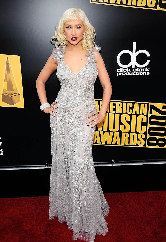 "Christina Aguilera glammed it up in a silvery lace gown that accentuated the singer's curves. Kevin Mazur/<a href=""http://www.wireimage.com"" target=""new"">WireImage.com</a> - November 23, 2008"