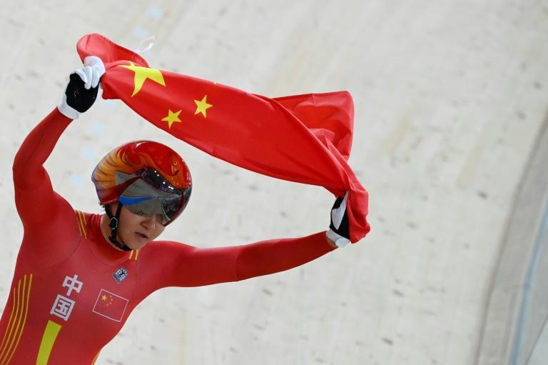 Zhong Tianshi celebrates after China won gold in the women's team sprint at the Izu Velodrome in Japan on Monday.