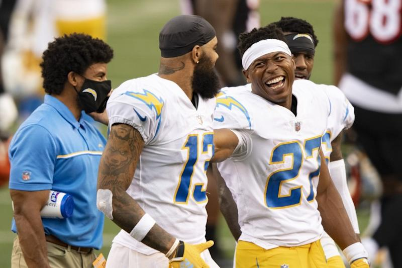 Los Angeles Chargers running back Joshua Kelley (27) and wide receiver Keenan Allen (13) celebrate their 16-13 win over the Cincinnati Bengals during an NFL football game, Sunday, Sept. 13, 2020, in Cincinnati. (AP Photo/Emilee Chinn)