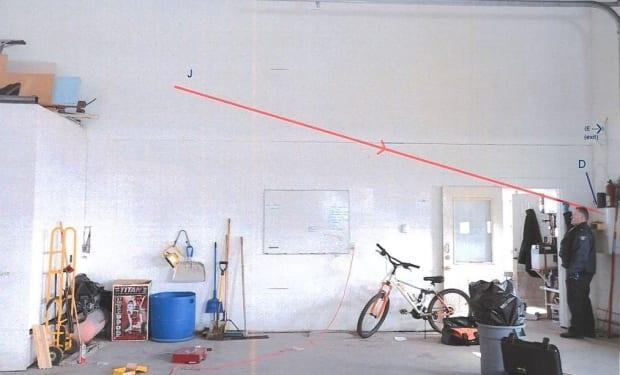 A court exhibit photo shows the trajectory of a bullet aimed at RCMP officers. (Court exhibit/RCMP - image credit)