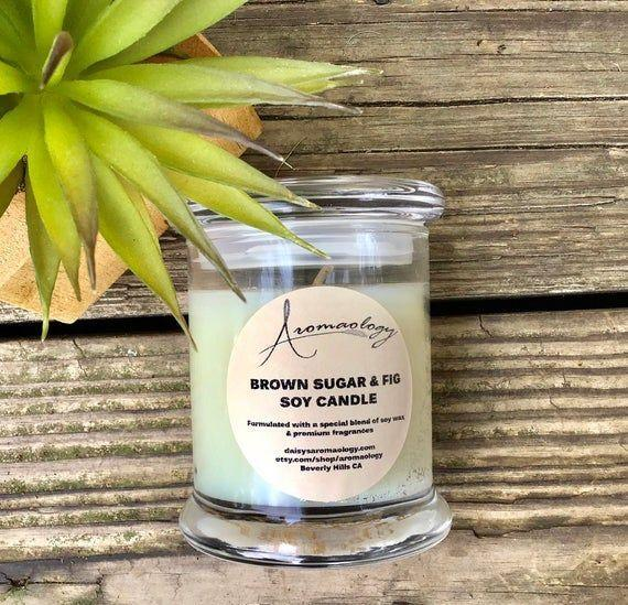 """<p><strong>Aromaology</strong></p><p>etsy.com</p><p><strong>$21.45</strong></p><p><a href=""""https://go.redirectingat.com?id=74968X1596630&url=https%3A%2F%2Fwww.etsy.com%2Flisting%2F153114662%2Fbrown-sugar-fig-candle-hand-made-soy&sref=https%3A%2F%2Fwww.housebeautiful.com%2Fshopping%2Fhome-accessories%2Fg22998163%2Fbest-christmas-scented-candles%2F"""" rel=""""nofollow noopener"""" target=""""_blank"""" data-ylk=""""slk:BUY NOW"""" class=""""link rapid-noclick-resp"""">BUY NOW</a></p><p>Fresh fig combines with notes of musk, coconut milk, and cedar for a fragrance that perfectly epitomizes """"cozy."""" </p>"""