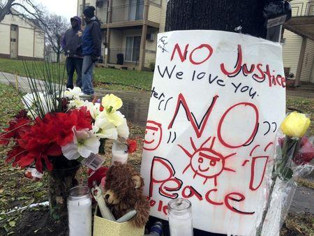 A makeshift memorial is seen at the location where Jamar Clark was allegedly shot by police early Sunday, in Minneapolis, Minnesota