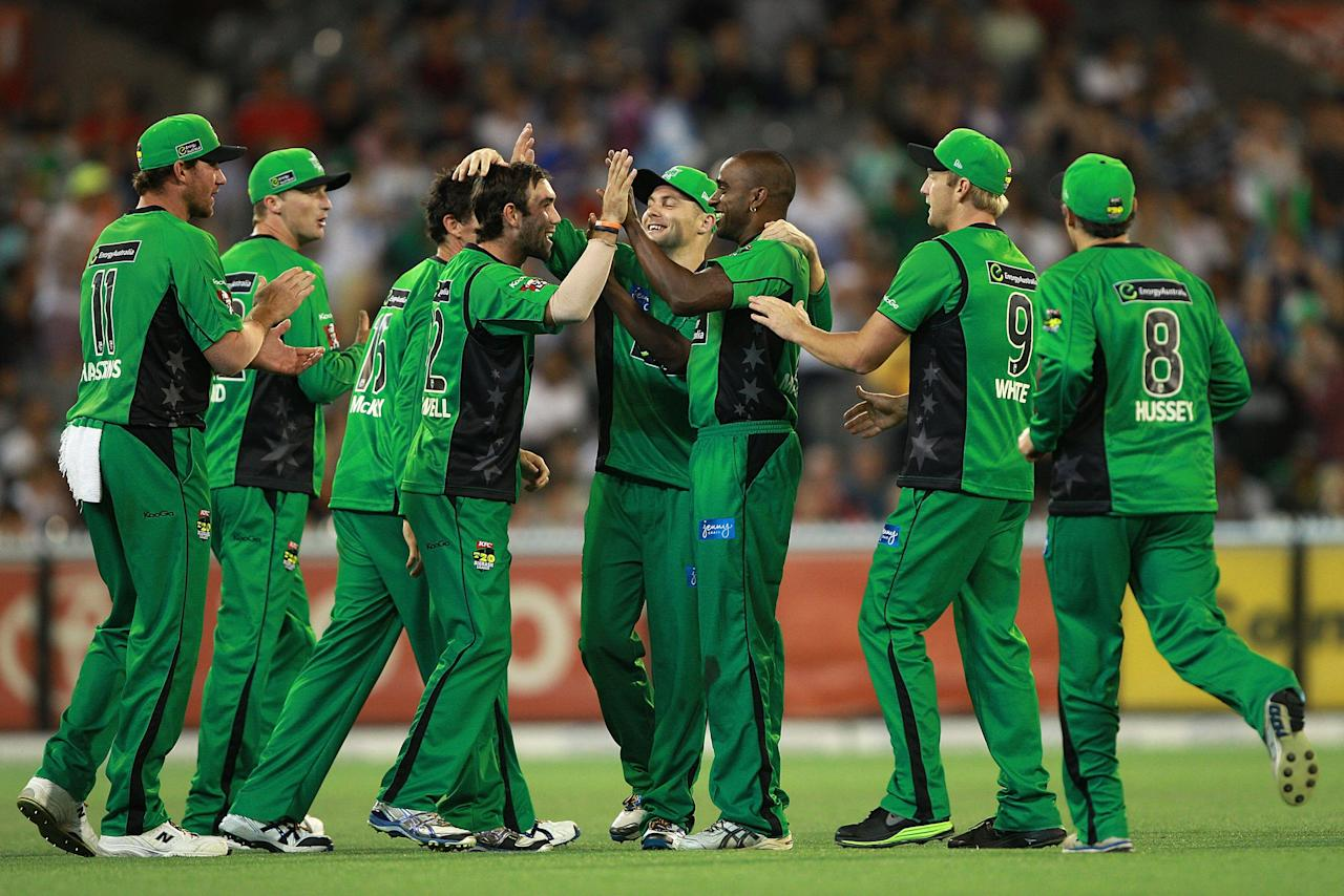 MELBOURNE, AUSTRALIA - JANUARY 08:  Dimitri Mascarenhas of the Stars celebrates the wicket of Chris Gayle of the Thunder during the Big Bash League match between the Melbourne Stars and the Sydney Thunder at Melbourne Cricket Ground on January 8, 2013 in Melbourne, Australia.  (Photo by Robert Prezioso/Getty Images)