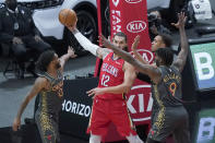 New Orleans Pelicans' Steven Adams (12) looks to pass the ball as Chicago Bulls' Coby White (0), Patrick Williams (9) and Daniel Gafford defend during the first half of an NBA basketball game Wednesday, Feb. 10, 2021, in Chicago. (AP Photo/Charles Rex Arbogast)