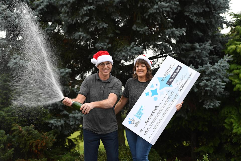 Andrew Clark and his partner Trisha Fairhurst celebrate their mammoth EuroMillions win. (PA)