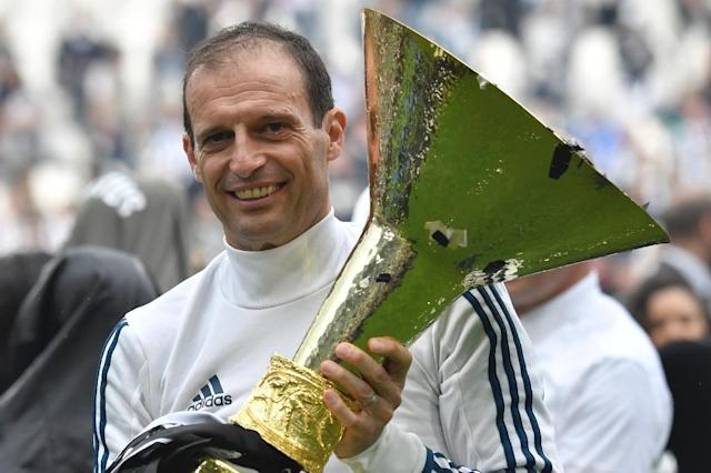 Juventus coach Massimiliano Allegri celebrates with the Serie A championship trophy at the weekend (AFP Photo/Andreas SOLARO)