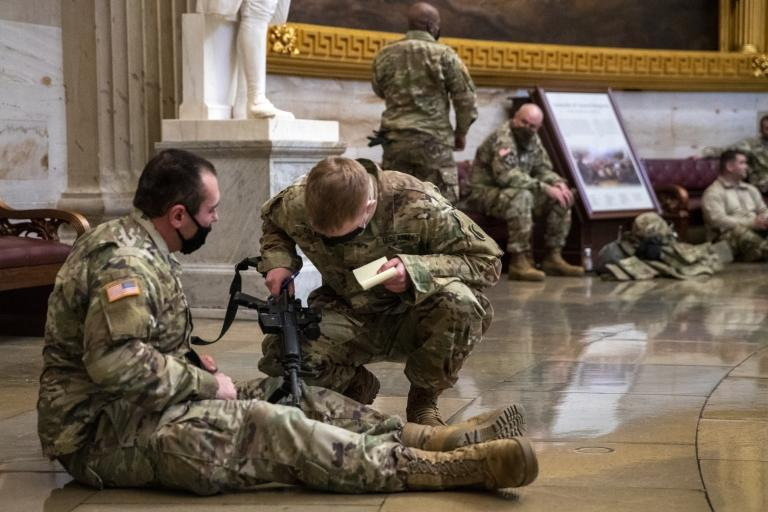 US National Guard soldiers taking a break inside the US Capitol in Washington